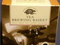 New, In Box & never used. Brewing basket is size Medium