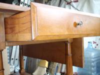 have a maple tea cart has 2 drop leafs and a shelf at