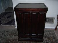 this is a beautiful tea Chinese cabinet in dark brown
