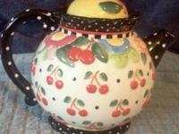 Cutest tea pot in the world! Cherries & stuff. Mary