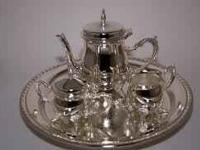 I HAVE A TEA SET MADE OUT OF SILVER VERY PRETTY. ITS
