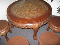 This is a mid century wood carved teakwood tea table
