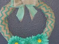 This wreath measures 15x15x4 inches. It would be a