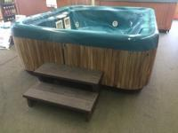 Teal marble Jacuzzi spa. runs on 110 v. (no spa box