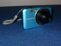 Selling A Teal Samsung Digital Camera For $ 25.00. In