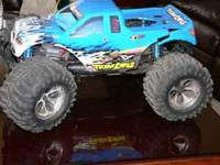 TEAM LOSI RC TRUCK WITH A BIG BLOCK HPI .27 MOTOR WITH