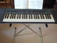 Model sx-k50 electronic keyboard with stand barely used