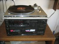 Comes with two speakers and 75 cassette tapes. Works