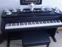 This is a like new Technics electric upright piano,
