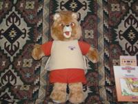 Vintage 1985 Teddy Ruxpin with 2 books and cassettes.
