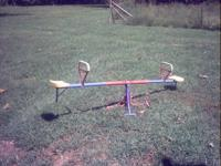 Description I have a teeter-totter it is yellow,red and