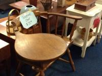 Wooden telephone chair with side drawer and table top.