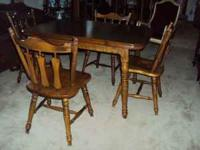 A nice dining room table & 4 chairs made by Temple