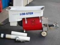 Lob-ster Tennis Ball Machine with cover. Osolating