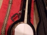 This Tenor banjo looks new. It is a Gretsch