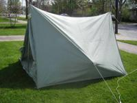 Basic pup tent style, A pole on each end, with ropes