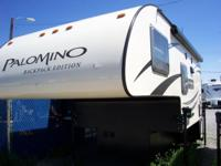 The 2014*Palomino truck camper is loaded with upgrades
