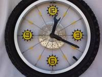 This is a bike tire clock. It is a real bike rim, tire,
