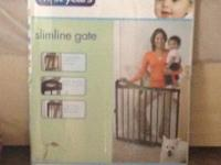 The First Years Slimline Gate includes a touch of