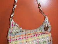 This is a Brand New purse with tags THE SAK!! If