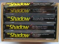 The Shadow 4 audio cassettes in a vintage wooden crate