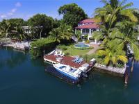 Welcome to The Sugar Mill, an exquisite gated bay front