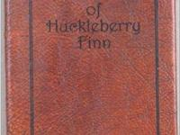 The Adventures of Huckleberry Finn by Mark Twain.