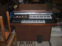 This is a great Thomas Organ with wooden bench. Organ