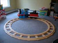 Thomas the train ride on toy with an 8 foot round