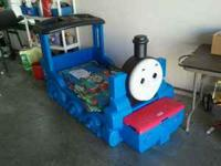 For sale is a used Thomas the Tank Engine toddler bed.