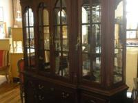TREASURES ITEM #17204  This china cabinet has cherry