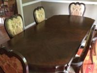 Beautiful THOMASVILLE dining room table and chairs.Paid