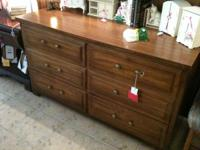 This dresser is in good condition with gold hardware.