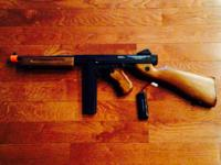 Like New- used Thompson Air-soft gun. Paid $194.99 for