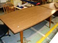 For sale we have a mid century dining table by famed