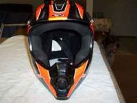 Like new dirt bike - motorcycle - helmet. Black with
