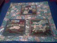 We have three homemade by my mother Baby quilts for
