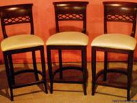 Cozy up to your home bar with these bar stools, dark
