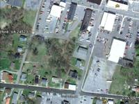 Three Contiguous Lots zoned for Company use found on