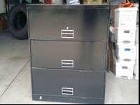Sturdy solid steel three drawer filing cabinet. Great