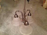 Like new brushed nickel three light chandelier.  $30,