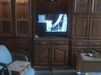 Illuminated three piece entertainment center plus