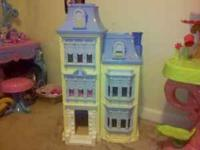 Three story doll house in good condition. From