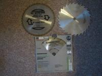 Up for grabs is three used ten inch table saw blades