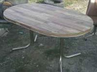 I HAVE A KITCHEN TABLE FORSALE, IT HAS A CENTER LEAF
