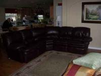 Three piece leather sectional includes four (4)