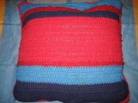 Pictured are two throw pillows. The first is HAND KNIT