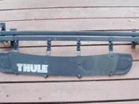Thule roof racks, not perfect, but very good condition,