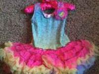 I am selling this tie dye tutu dress for $15 with tags