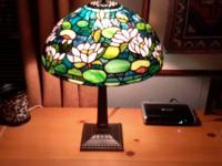 This is a lovely stained glass lampshade of an actual
